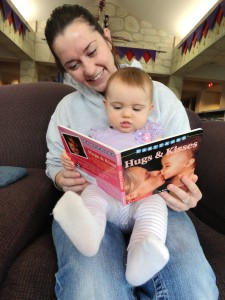 Nichole Luzar shows a Born to Read board book to her newborn, Lylah Kitchen. Mentor Public Library and Lake Health have partnered for the Born to Read program, which provides a free board book, feeder and bib to new parents.