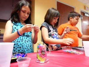 Each of the kids could choose what color material they would fill their sun catchers with.
