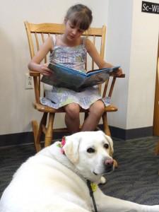 Bela reads the adventures of CatDog to Hayley.