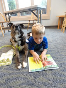 Jay and Fragg share a book at our Mentor-on-the-Lake Branch.