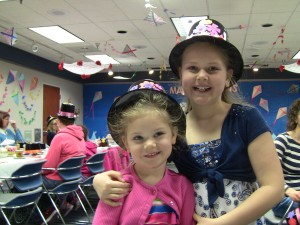 Gigi and Jenna show off their new hats.