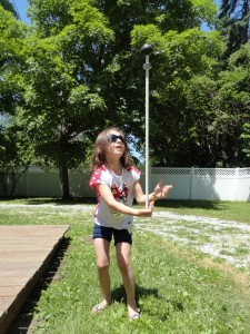 Elizabeth tries to balance COSI's rod and learns an object lesson in gravity and momentum.