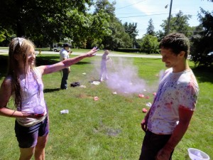 Teens throw colored dye at one another during our Holi celebration last summer.