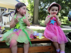 Kacey and Annalise grab a quick snack after an afternoon of granting wishes yesterday by our Read House.