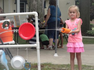 Clara plays percussion by spraying a Splash Orchestra with water.