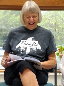Dee Tarentino laughs during a Know Poe book talk at Mentor Senior Center.