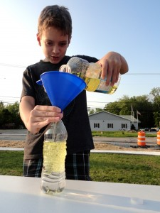 Jack fills his bottle with oil and water and lets them settle.