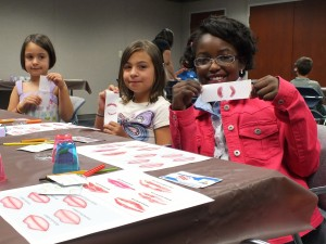 The kids learn how to identify different kinds of lip prints, just like they were fingerprints.