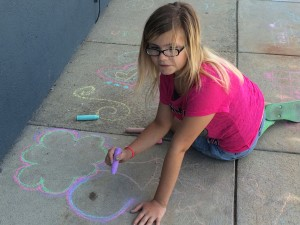 Getting creative with the chalk on the Headlands Branch sidewalk.