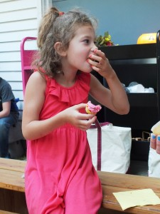 Hazel's dress coincidentally coordinated with her cupcake.