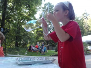 Libby Davis tries to blow the world's most stupendous bubble during our Summer Reading finale party.