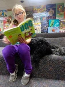 Aylish reads Dog Rules to Kody.