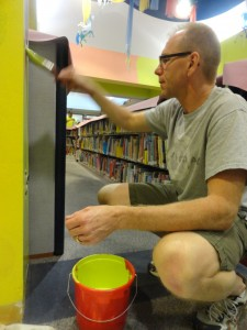 Gary Sheplavy helps brighten the children's department.