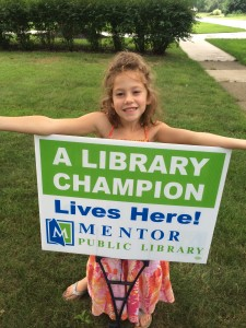 Kids earned Library Champion signs by reading (or being read to) for 15 hours.
