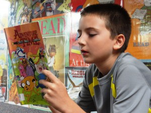 Nicholas checks out an issue of Adventure Time during our Comics Club.