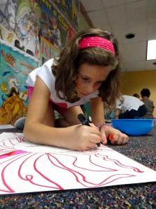Kelsey focuses on her pink and magenta locks.