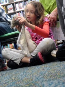 Cheyenne touches the soft fur of an opossum that lived in the marsh.