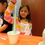 Alyssa tests the slime to make sure it's good and sticky.