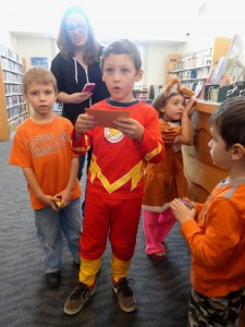 Darin—pardon me, The Flash—reads a clue during the Halloween scavenger hunt.