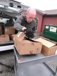 A volunteer at St. Gabriel's food pantry helps unload food you donated.