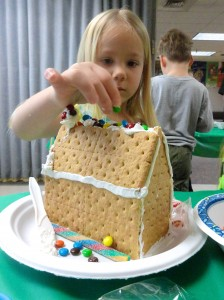 Laci carefully places each M&M on her graham-cracker home.