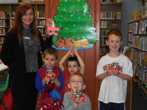 Kids show off the holiday gifts they made during our annual Christmas program at our Headlands Branch.