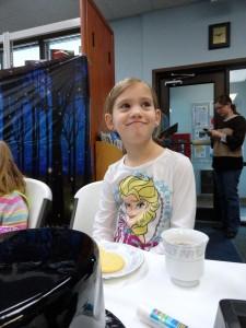 Kylie enjoys a sip of tea during the Wonderland Tea Party.