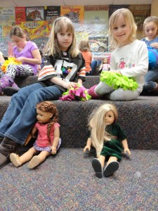 Maddie and Clara (along with dolls, Sage and Isabel,) work on their craft at the book club.