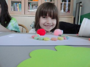 Maddie makes a colorful Fruit Loops rainbow during our St. Patrick's Day party. (We must have run out of Lucky Charms.)