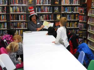 Terri, one of our MPL Board members, reads to the children during a special Seuss story time at our Headlands Branch.