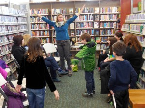 Kids practice flapping their wings at Mentor Library's Headlands Branch.