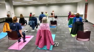 Jessica Humphrey demonstrates some chair yoga moves during a Beginners Yoga class at Mentor Library.