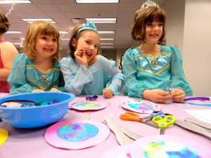 Grace, Abby and Meghan stop to smile while making their magical mirrors.