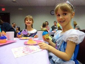 Emmie and Ellie share cupcake-stained smiles during our tea party.