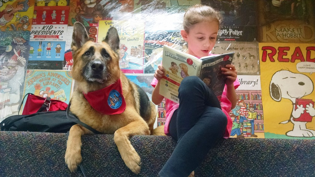 There are few audiences as supportive as a canine. Diva listens to Noni read during Paws to Read at Mentor Library.