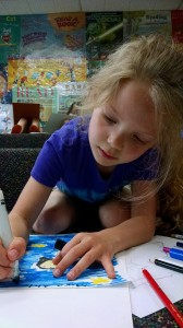 Mira recreates a Pablo Picasso painting with markers during Studio MPL, an art club for kids at Mentor Library.