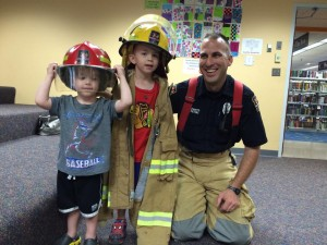 Firefighter Nathan Peters was kind enough to share his gear with some of the children.