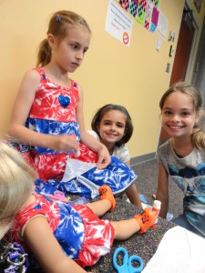 Katie, Mckenzie and Tabitha make a quilt together during the most recent meeting of our American Girl Book Club.