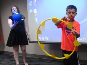Ms. Marilyn demonstrates how the earth rotates around the sun. (The sun, in this instance, is played by Matthew.)