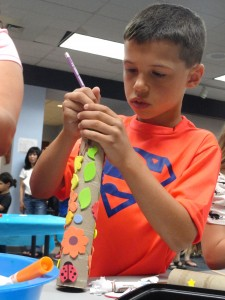 Joseph decorates his telescope at Mentor Library.