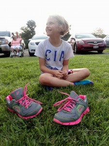 Cassie kicks off her shoes during a free concert at Mentor Library's Headlands Branch.