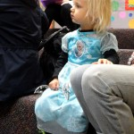 Princess Cora listens during story time.