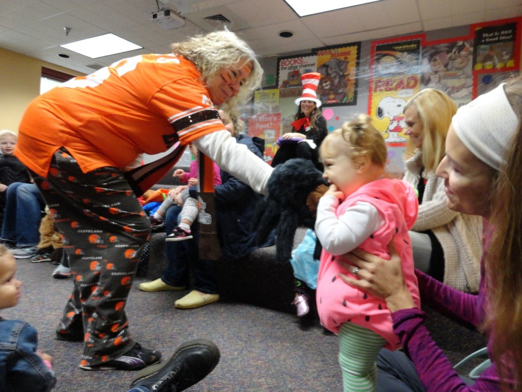 Kim Sidorick, manager of MPL's children's department, hands out spider kisses during story time.