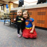 It's a superhero teamup! Bri and Maddie trick or treat as Batgirl and Supergirl at Mentor Public Library.
