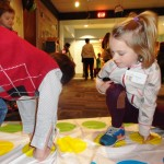 Luke and Madelyn face off in a Twister competition.