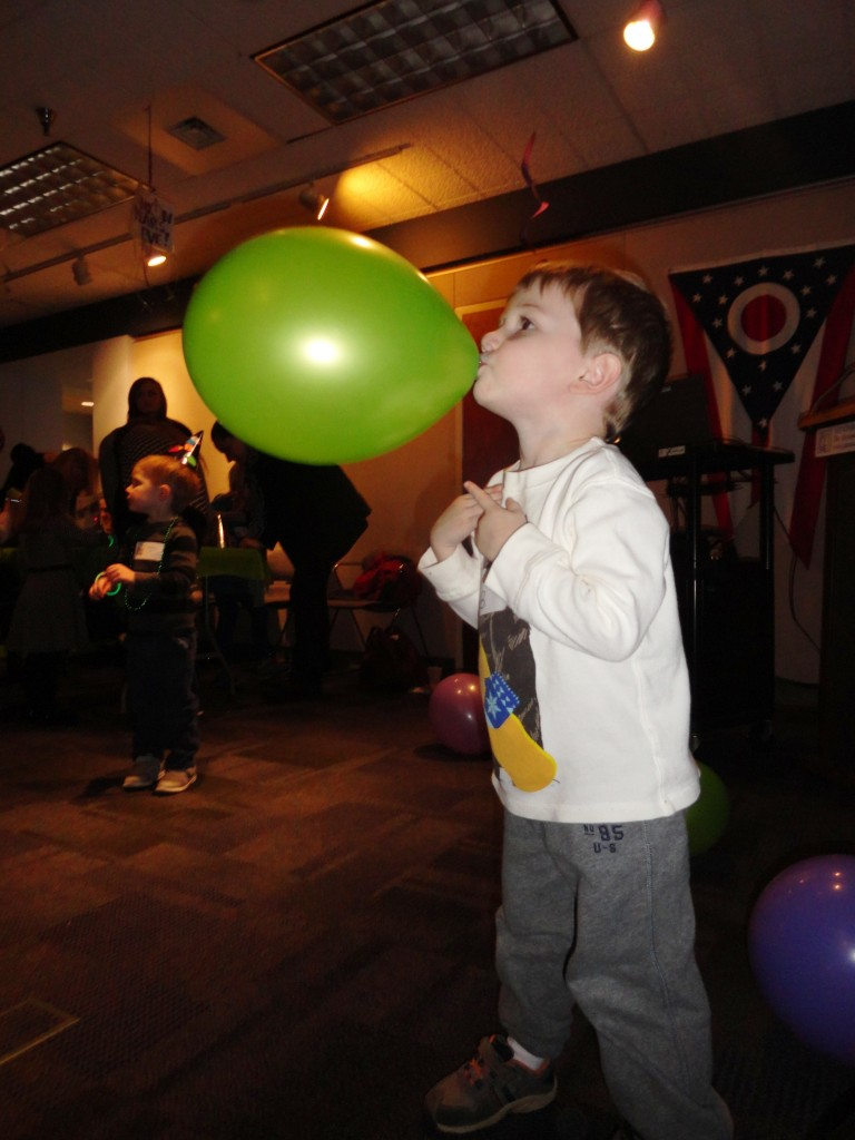 Bo plays with one of the balloons during our Happy Noon Year party on Thursday.