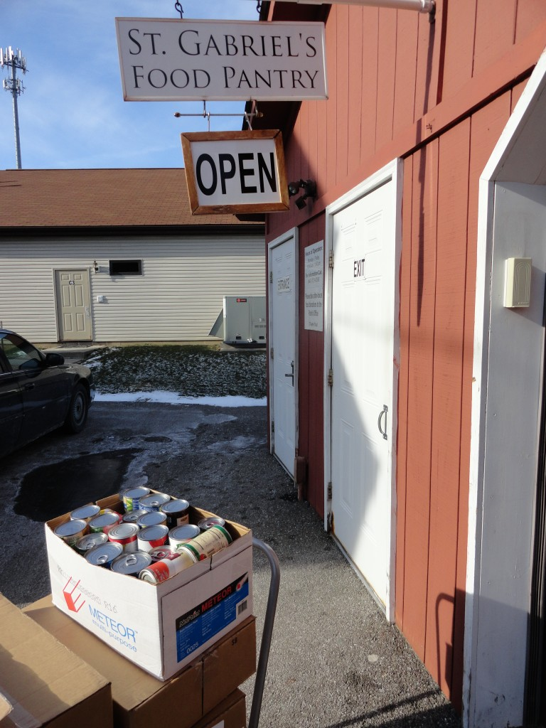 Mentor Library delivers 12 boxes of donated food to the St. Gabriel's food pantry.