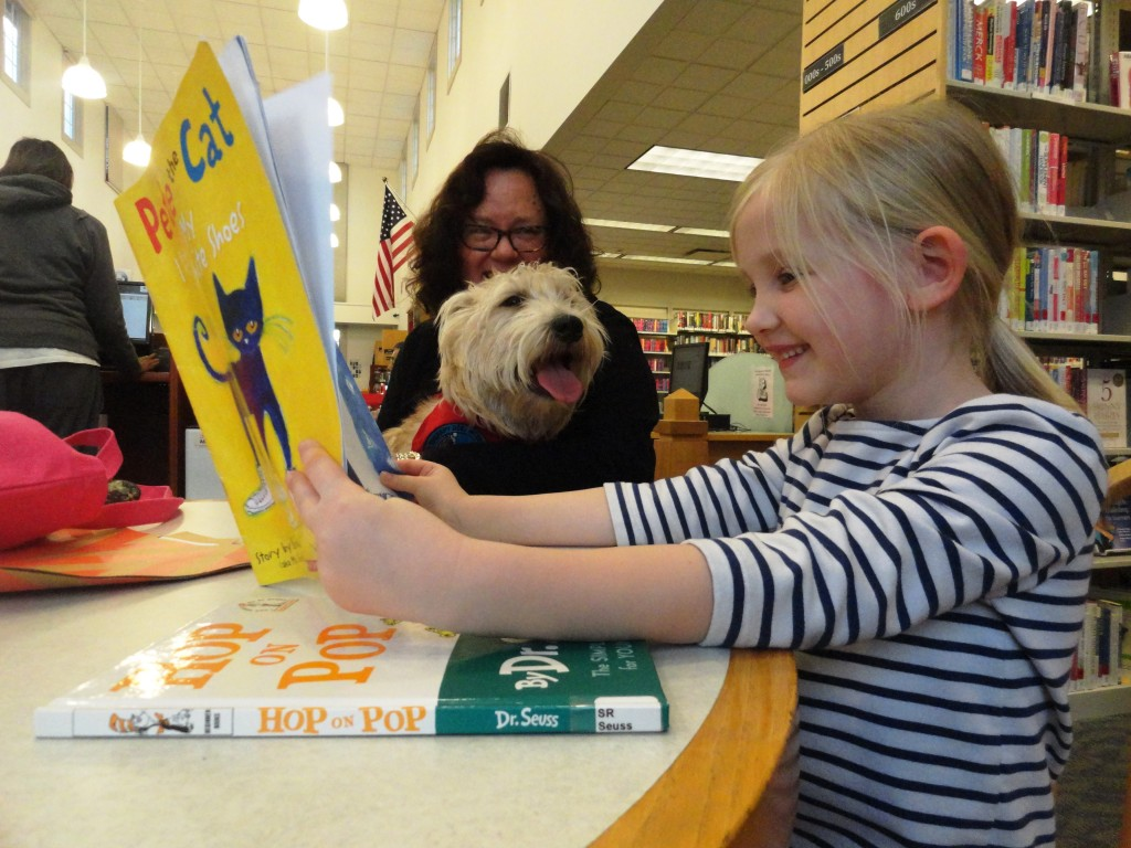 Reading Pete the Cat? At Paws to Read? But Hattie enjoys Anna's book selection, so who are we to complain?