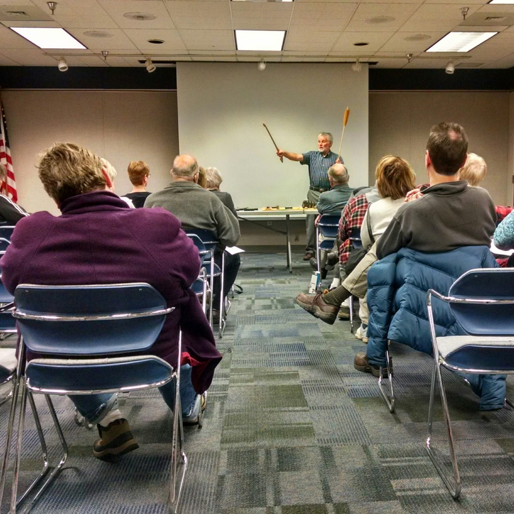 Bill Urbanski demonstrates how an atlatl works at Mentor Public Library.