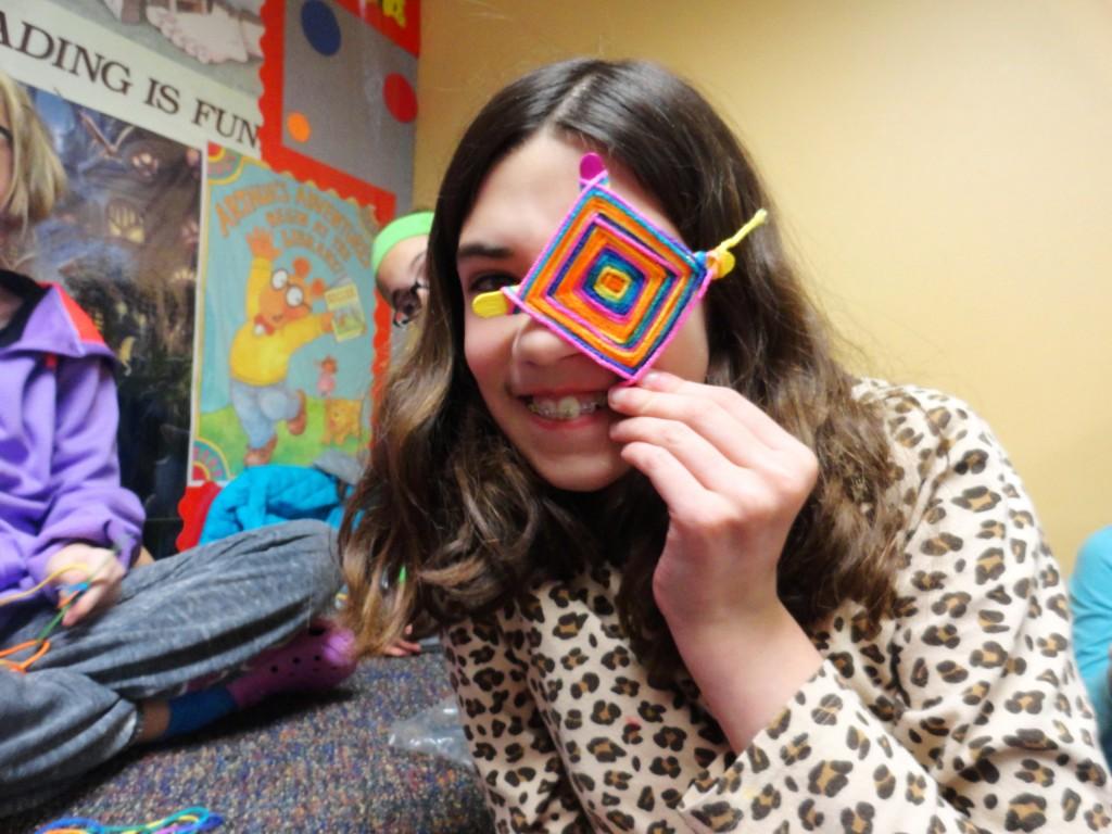 Abby uses her God's-eye as an eye patch.
